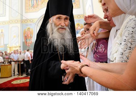 Orel Russia - July 28 2016: Russia baptism anniversary Divine Lutirgy. Orthodox Christian monk starets Iliya blessing parishioners closeup
