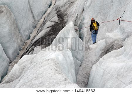 A man descends a glaicer in Iceland