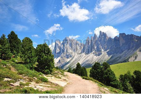 Hiking path in the Alps on summer, Italy