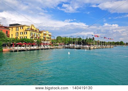 SIRMIONE ITALY - JULY 14: View of harbor in Sirmione Italy on July 14 2014. Sirmione is a resort on Garda lake in northern Italy.