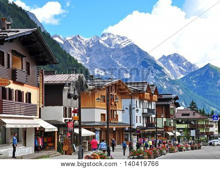 MADONNA DI CAMPIGLIO ITALY - JULY 11: View of the main pedestrian street in Madonna di Campiglia Italy on July 11 2014. Madonna di Campiglia is a ski resort in Dolomites Alps Italy.