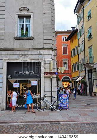 TRENTO ITALY - JULY 23: People on the street of Trento historical centre Italy on July 23 2014. Trento is a city in northern Italy the capital of Trentino Alto province.