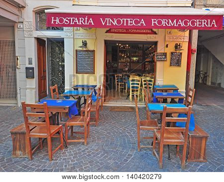 SIRMIONE ITALY - JULY 14: Tables and chairs in the typical italian restaurant in Sirmione Italy on July 14 2014. Sirmione is a resort on Garda lake in northern Italy.