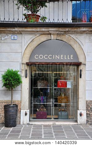 BOLZANO ITALY - JULY 20: Facade of a flagship store of Coccinelle fashion brand in Bolzano Italy on July 20 2014. Coccinelle is a brand in the production of fashion bags and accessories founded in 1978 at Parma.