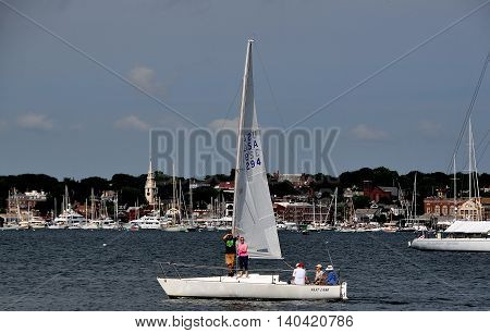 Newport Rhode Island - July 17 2015: Sallboat cruising the waters of Narragansett Bay on a summer afternoon