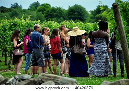 Middletown Rhode Island - July 18. 2015: Visitors on a tour at the renowned Newport Winery vineyards learn about viticulture