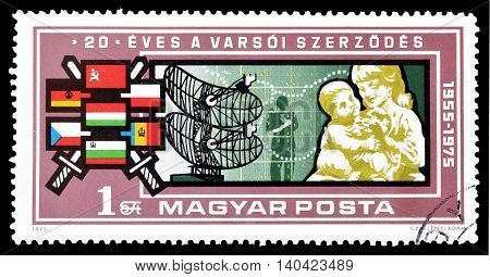 HUNGARY - CIRCA 1975 : Cancelled postage stamp printed by Hungary, that shows flags, radar, mother and a child.