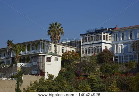 VALPARAISO, CHILE - JULY 5, 2016: Historic buildings lining the hills of the UNESCO World Heritage port city of Valparaiso in Chile.