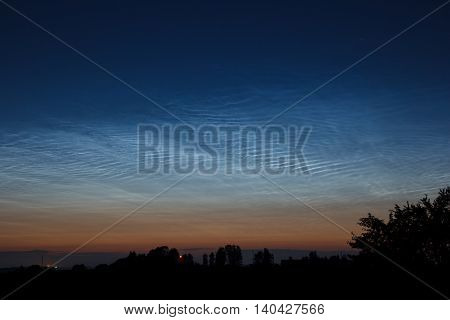 Night clouds or noctilucent clouds are tenuous cloud-like phenomena that are the ragged edge of a much brighter and pervasive polar cloud layer called polar mesospheric clouds in the upper atmosphere, visible in a deep twilight. They are made of ice cryst