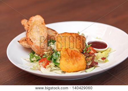 Potato Pancakes With Vegetable Salad And Homemade Bread.