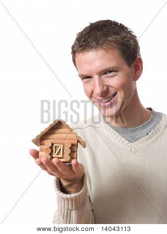 man with tiny cabin