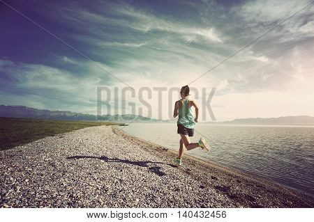 healthy young fitness woman runner running on seaside trail