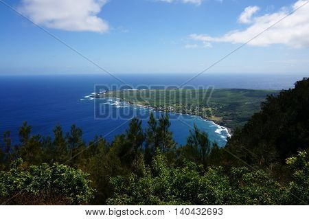 Waves roll towards Kalaupapa Peninsula on Molokai which is the site of Saint Damiens mission where he ministered for 16 years to those suffering from Hansen disease. Seen from lookout.