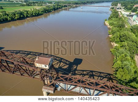 Historic railroad Katy Bridge  over Missouri River at Boonville with a lifted midsection - aerial view