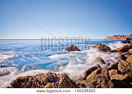 Ocean water flowing over cliffside rocks in Rancho Palos Verdes, California.