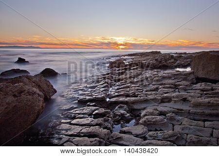 Sunset on the rocks of Rancho Palos Verdes, California