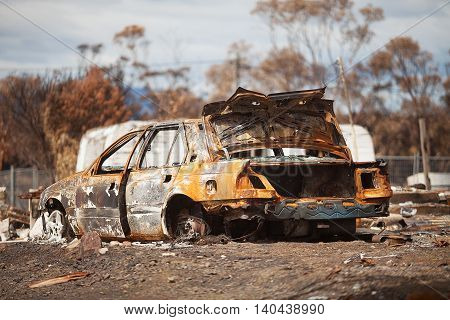Burnt out motor vehicles and trees, destroyed by bushfire, Dunalley, Tasmania