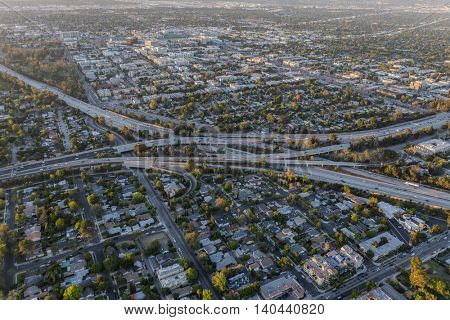 Late afternoon aerial of the Ventura and Hollywood freeways interchange in Los Angeles.