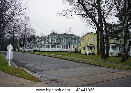 WEQUETONSING, MICHIGAN / UNITED STATES - DECEMBER 22, 2015: Large homes on Second Avenue in Wequetonsing, Michigan.