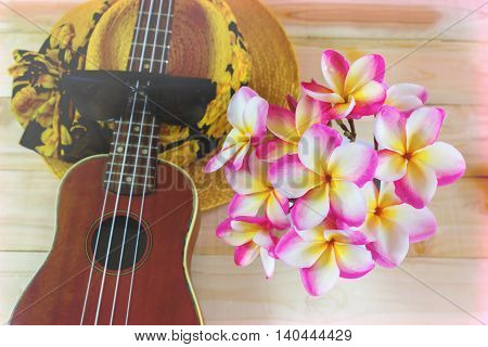 Flowers Bunch Plumeria Or Frangipani With Ukulele And Summer Hat