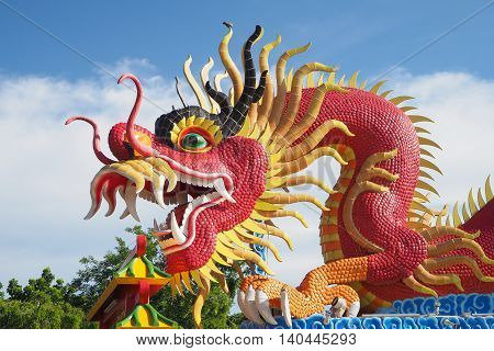 Red big dragon statue in public place of worship Chonburi province Thailand.