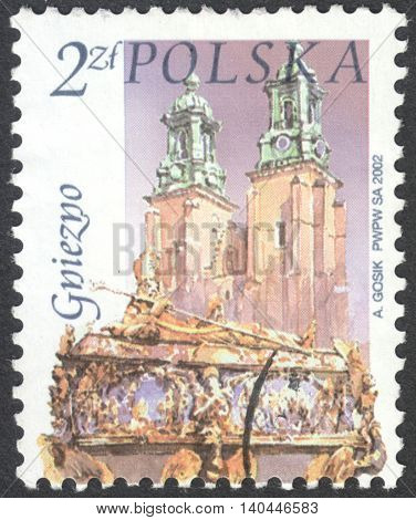 MOSCOW RUSSIA - CIRCA APRIL 2016: a post stamp printed in POLAND shows a view of Gniezno town the series