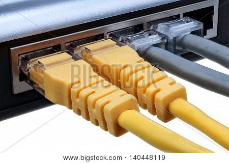 Network hub with plugged ethernet cables LAN isolated on white background with clipping path closeup