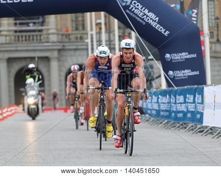 STOCKHOLM SWEDEN - JUL 02 2016: Group of male triathlete cyclists Jonathan Brownlee (GBR) Raoul Shaw (FRA) and competitors in the Men's ITU World Triathlon series event July 02 2016 in Stockholm Sweden