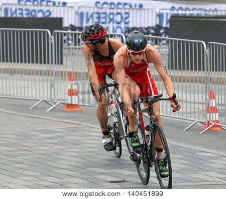 STOCKHOLM SWEDEN - JUL 02 2016: Male triathlete cyclists Andreas Schilling and Xavier Grenier-Talavera in the Men's ITU World Triathlon series event July 02 2016 in Stockholm Sweden
