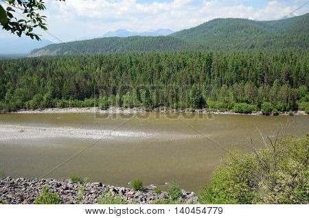 Irkut River in its beginning in the Sayan Mountains in sunny day