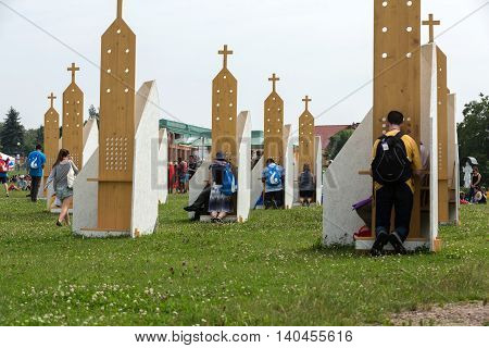 CRACOW POLAND - JULY 26 2016: Pilgrims in Zone of Reconciliation at Sanctuary of Divine Mercy in Lagiewniki. WYD participants will be able to confess to more than 50 confessionals. Cracow Poland