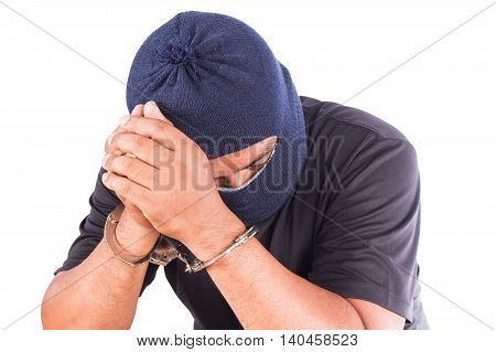Young man suspect hand in handcuff  on white background
