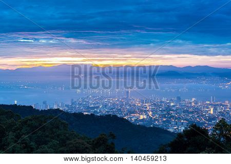 Metropolitan cityscape view from top of the hill or mountain during sunrise sunset