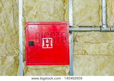 Front side of fire box with symbol for hydrant in an unfinished party wall.