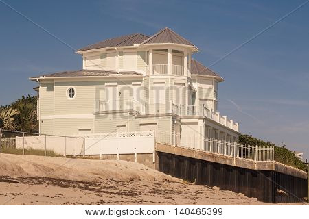 Beach houses and wooden beams and staircase to the beach, southern Florida