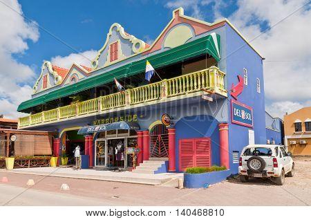 Kralendijk Bonaire - December 2 2011: On Main Street Kralendijk stands a colorful shop Harborside Del Sol, containing shop and restaurant.