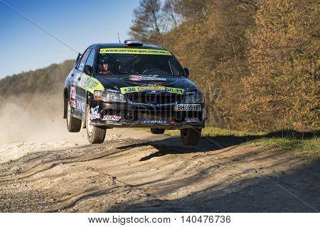 Lviv Ukraine - November 1 2015: Ruslan Topor's Mitsubishi Lancer Evo IV (No.24) competes at the annual Rally Galicia