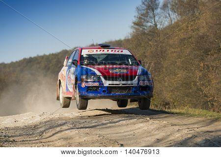Lviv Ukraine - November 1 2015: Boris Ganga's Mitsubishi Lancer Evo IX (No. 2) competes at the annual Rally Galicia