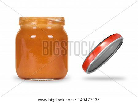 Open jar of jam or baby food on a white background