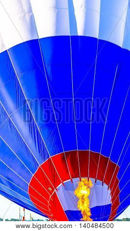 Close up of a hot air balloon getting filled before take off.