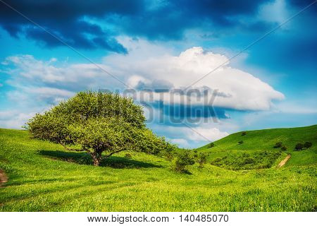 Majestic mountains landscape under morning sky with clouds. Overcast sky before storm. Caucasus Russia