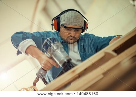 Safety-conscious contractor or homeowner working with nail gun