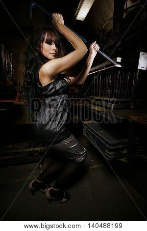 Brunette In Heels Posing In An Old Workshop