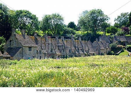 BIBURY, UNITED KINGDOM - JULY 20, 2016 - View of the Arlington Row cottages Bibury Cotswolds Gloucestershire England UK Western Europe, July 20, 2016.