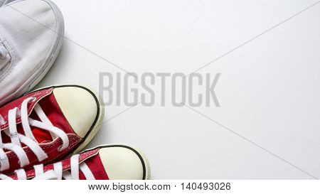 Red and white shoes at conner on white background.