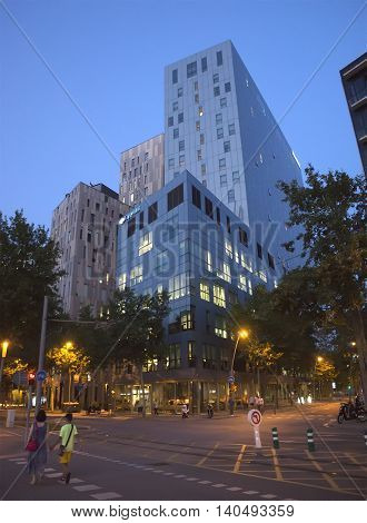 BARCELONA SPAIN - JULY 1 2016: Modern buildings in Barcelona located near the Agbar Tower. Night view.