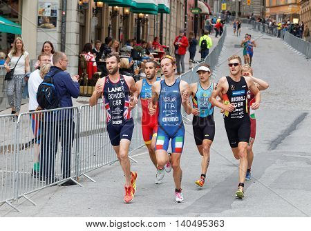 STOCKHOLM - JUL 02 2016: Side view of running triathletes in the Men's ITU World Triathlon series event July 02 2016 in Stockholm Sweden