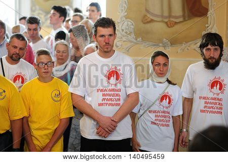 Orel Russia - July 28 2016: Russia baptism anniversary Divine Liturgy. Young volunteers at sermon in church horizontal