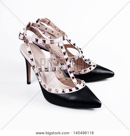 Pair of black patent leather female shoes isolated on white background