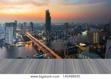 Opening wooden floor, After sunset over Bangkok main river curved, Thailand